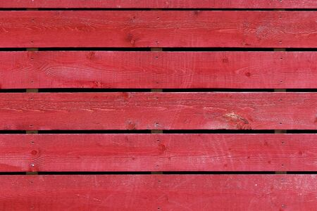 painted wood: Close up shot of wood painted red
