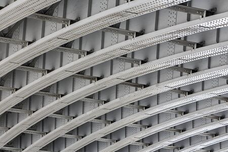 girders: Shot of the underside of a bridge showing the support girders Stock Photo