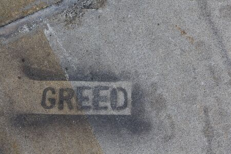 Grungy texture with the word greed stamped on it Imagens
