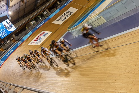 LONDON - FEBRUARY 2015: Cyclists practicing in Lee Valley Velodrome Editorial