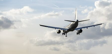 Passenger airliner with landing gear deployed, making final approach