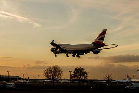 airways: British Airways Passneger Jet Landing Approach at Sunset. Boeing 747