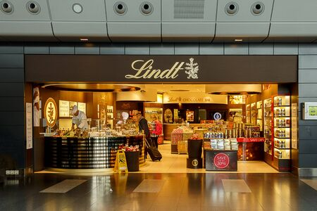 lindt: Shot of a Lindt Chocolate store at an Airport