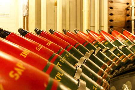 calibre: Shot of heavy calibre ammunition shells on an ammunition rack.