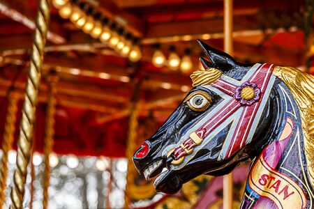 Close up shot of a fairground horse on a merry go round