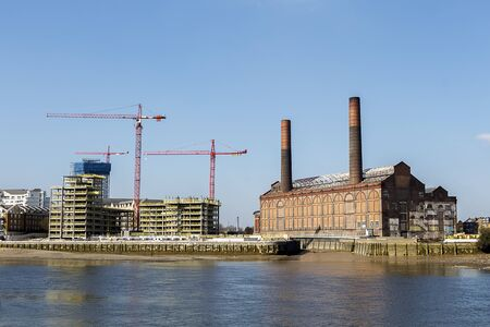 regeneration: Waterfront Apartments Under Construction in West London, part of a huge regeneration project on the River Thames Editorial