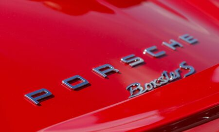 SURREY, UK - CIRCA 2015: Porsche Badge Close Up Editorial