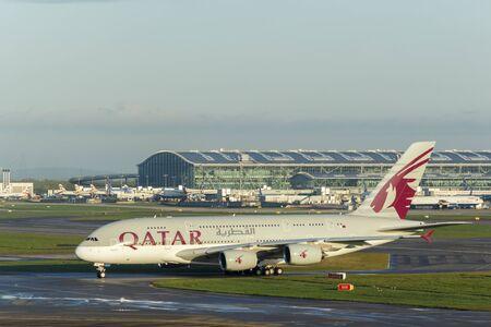 long haul journey: LONDON, UK - CIRCA 2016: Qatar Airways Airbus A380 Taxiing at Heathrow Airport