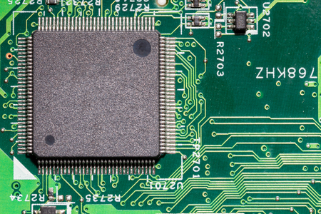 Large Computer Chip  on a Printed Circuit Board Stock Photo