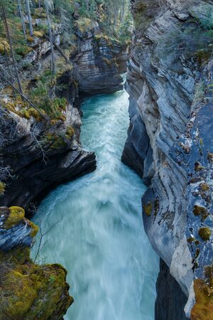 Looking down into a canyon with fast flowing water