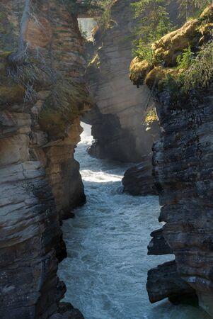 Water flowing through a deep narrow canyon Stock fotó - 124940872