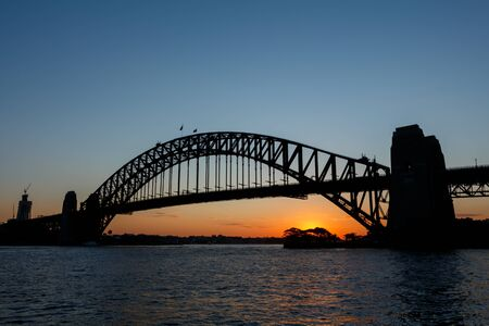 Silhouette of Sydney Harbour Bridge viewed from Kirribilli at sunset Stock Photo