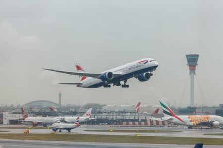 London, England - Circa 2019 : British Airways Boeing 787 Dreamliner GZBKL Taking off from LHR Airport in bad weather