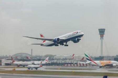London, England - Circa 2019 : British Airways Boeing 787 Dreamliner GZBKL Taking off from LHR Airport in bad weather