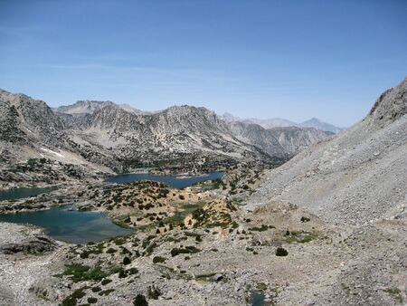 muir: Title: Bishop Lake Location: Bishop Lake is in the Sierra Nevada Mountains of California. When approaching the John Muir Trail from the eastern Sierra, a popular lateral is to start at South Lake (west of Bishop, CA) and hike over Bishop Pass. Bishop Lake