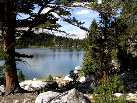 john muir trail: Title: Bullfrog Lake Location: Bullfrog Lake is in the Sierra Nevada Mountains of California. When approaching the John Muir Trail from the eastern Sierra