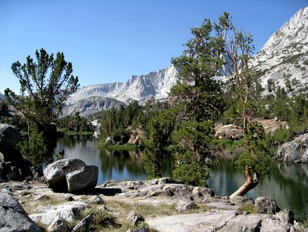 john muir trail: Title: Long Lake Location: Long Lake is in the Sierra Nevada Mountains of California. When approaching the John Muir Trail from the eastern Sierra, a popular lateral is to start at South Lake (west of Bishop, CA) and hike over Bishop Pass.