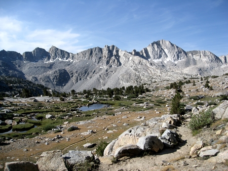 john muir trail: Title: Upper Dusy Basin Location: Upper Dusy Basin is in the Sierra Nevada Mountains of California. When approaching the John Muir Trail from the eastern Sierra, a popular lateral is to start at South Lake (west of Bishop, CA) and hike over Bishop Pass.