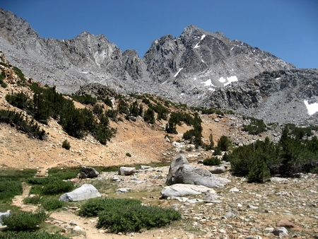 john muir trail: Title: Bishop Pass Trail Location: Bishop Pass is in the Sierra Nevada Mountains of California. When approaching the John Muir Trail from the eastern Sierra, a popular lateral is to start at South Lake (west of