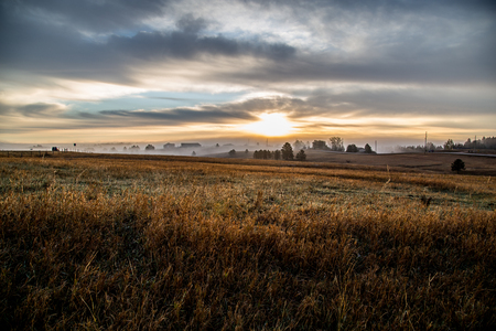 vintage photo: foggy morning on meadow. sunrise landscape photo with vintage effect Stock Photo