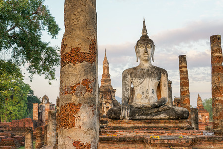thai buddha: Buddha statue in old Buddhist temple ruins. Buddha statue in Sukhothai historical park Wat Mahathat.
