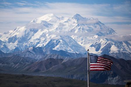 mckinley: usa flag with mount mckinley in background, denali national park