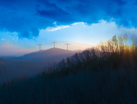 Three Crosses on a Hill at Dusk