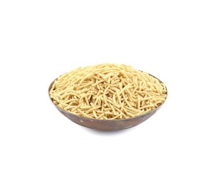 sev: Indian Namkeen Food Aloo Sev also know as namkin and nimco a popular crisp savory snack made from mashed potatoes, chickpea flour and spices. Stock Photo