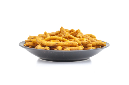 Sev is a popular Indian snack food consisting of small pieces of crunchy noodles made from chickpea flour paste, which are seasoned with turmeric, cayenne, and ajwain before being deep-fried in oil.