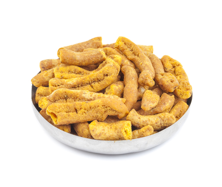 sev: Ganthiya Also know as Gathiya, Ghatiya are deep fried Indian snacks made from chickpea flour. They are a popular teatime snack in Gujarat. They are soft and not crunchy like most other Indian snacks Stock Photo