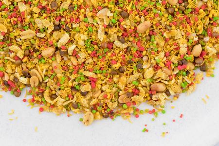 Indian Namkeen Food Navratan Mixture or Navratna Mix Namkeen Also Know As Nimco, Namkin, Mixture or Nimko Isolated on White Background