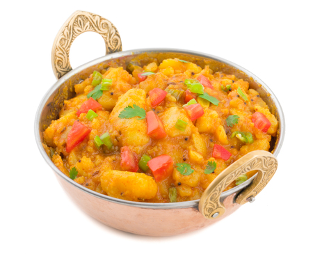 Indian Cuisine Spicy Fried Aloo Also Know as Potato Fry, Potato Curry, Aloo Masala or Alu Masala isolated on White Background