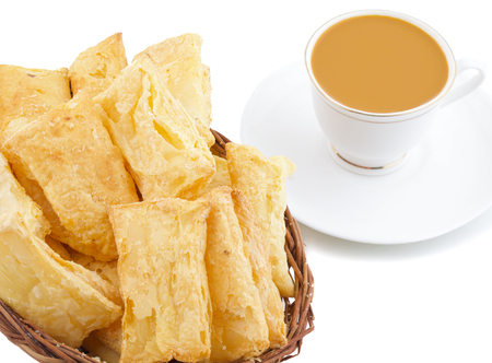 Indian Tea Time Breakfast Khari Also Know as Kharee, Khari Biscuit or Salty Puff Pastry Snacks, Served with Indian Hot Masala Chai or Hot Tea Isolated on White Background 版權商用圖片