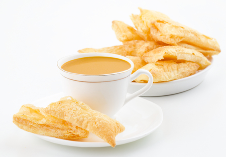 Indian Tea Time Breakfast Khari Also Know as Kharee, Khari Biscuit or Salty Puff Pastry Snacks, Served with Indian Hot Masala Chai or Hot Tea Isolated on White Background Stock Photo