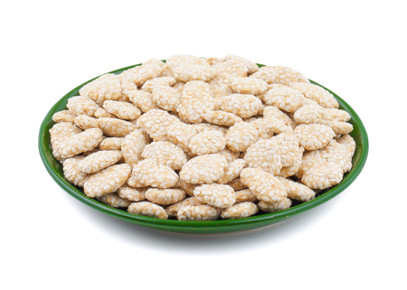 Indian Sweet Food Rewri also know as rewadi are popular in the Indian makar sankranti festival, Rewri is crisp toffee like dessert made from gudh (with spices) with coating of sesame seeds. Imagens