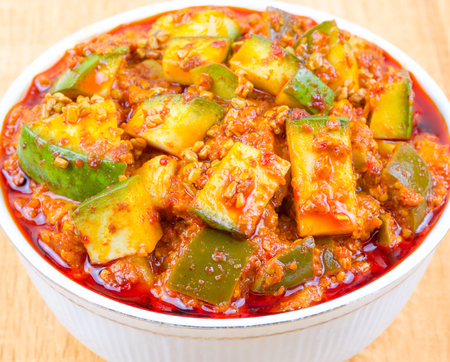 Indian Traditional Raw Mango Pickle Also Know as Aam Ka Achar or Kari Ka Achar on Wooden Background