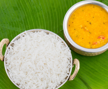 Indian Traditional Cuisine Dal Fry or Rice Also Know as Dal Chawal, Daal Chawal, Dal Rice, Whole Yellow Lentil with Rice or Dal Tadka, Daal Fry Served with Rice on Banana Leaf Stock Photo