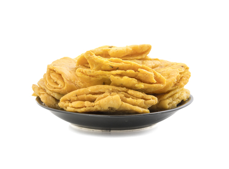 Indian Bakery Food called as Khari Snack, Khari Biscuit or Jeera Khari, Indian Tea Time Snack isolated on white background Stock Photo