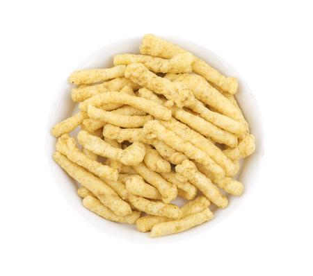 Indian Street Food Spicy Kurkure Also Know as Namkeen Sticks, Green Chutney Kurkure isolated on White Background Stock Photo