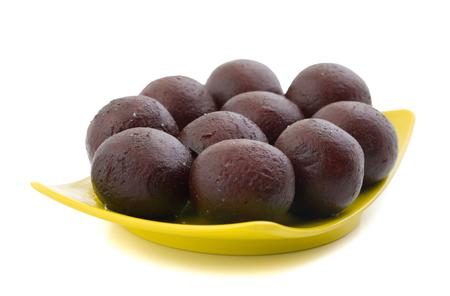 Indian Sweet Food Sweet Black Gulab Jamun Also Know as Kala Jamun, Black Jamun or Dry Kala Jam is a Popular Indian Dessert or Doughnuts for Festivals And Weddings
