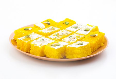 Indian Popular Sweet Food Khopara Pak or Coconut Burfi made up of Coconut, Milk And Sugar Isolated on White Background