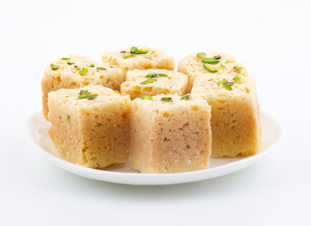 Indian Traditional Famous Sweet Food Mysore Pak or Mysoor Pak Isolated on White Background