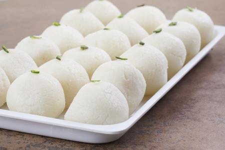 Indian Sweet Rasgulla Also Know as Rosogolla, Roshogolla, Rasagola, Ras Gulla, Anguri Rasgulla or Angoori Rasgulla is a Syrupy Dessert Popular in India. It is Made From Ball Shaped Dumplings