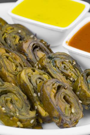 Indian Spicy Food Patra Also Called Paatra, Alu Vadi or Patrode is a Veg Dish in Maharashtra or Gujarati Cuisine. It is Made from Colocasia Leaves Stuffed with Rice Flour And Spices, Tamarind, Jaggery Imagens