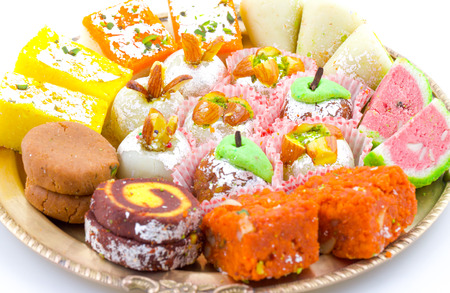 Indian Traditional Mix Sweet Food or Mix Mithai include Peda, Mawa Burfi, Dry Fruits Sweet, Halwa or Coconut Burfi Stock Photo