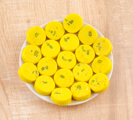 Indian Sweet Food Kesar Peda Also Know as Kesar Mawa Peda, Saffron Sweet, Saffron Peda, Pedha, Pera or Peday is a Saffron Flavoured Soft, Dense Sweet That is Specially Made During Festivals