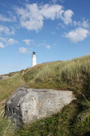 Hirtshals Lighthouse with a bunker from le the second world war Stock Photo