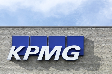 auditors: Aarhus, Denmark - August 8, 2015: KPMG logo on a facade. KPMG is one of the largest professional services companies in the world and one of the big four auditors