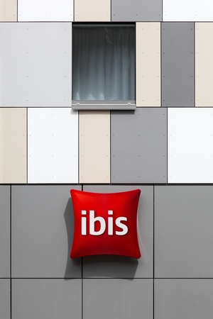 Esch sur Alzette, Luxembourg  - July 12, 2015: Ibis hotel sign on a wall. Ibis is an international hotel company, owned by a holding company of hotels AccorHotels Editorial