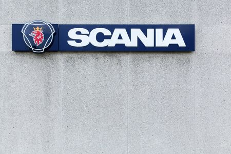 manufacturer: Horsens, Denmark - July 4, 2015: Scania sign on a wall. Scania, is a major swedish automotive industry manufacturer of commercial vehicles specifically heavy trucks and buses. Editorial